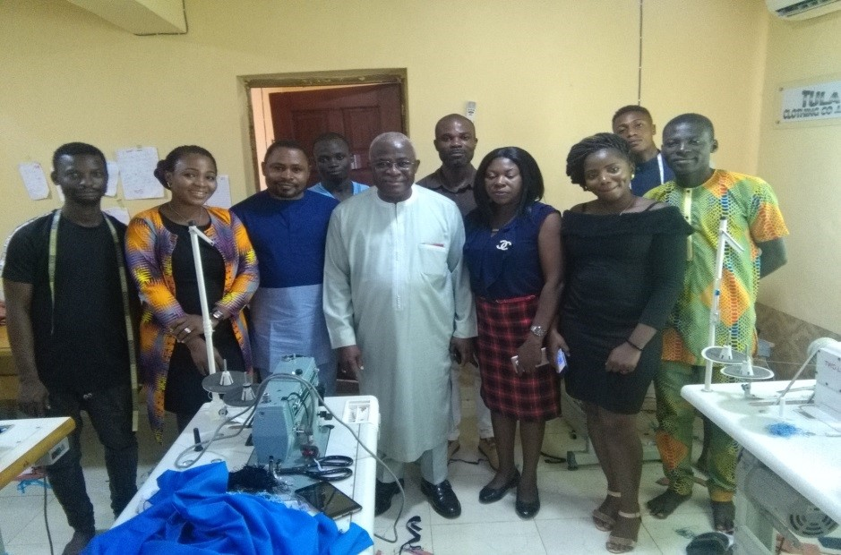 Dr. Nwanze, Tula Clothing CEO and workers